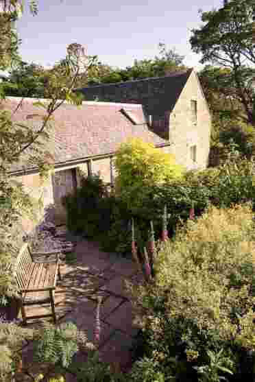 Country cottage gardens, idyllic in summer, not have fire pits to gather around with a whisky in the evenings