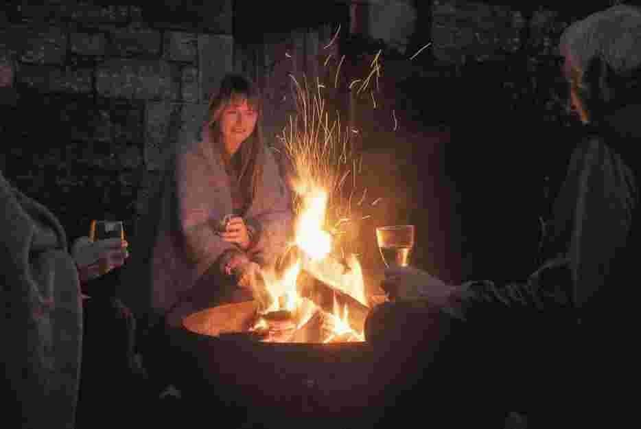 Gathering round a fire at Eastside, Pentland Hills, Edinburgh