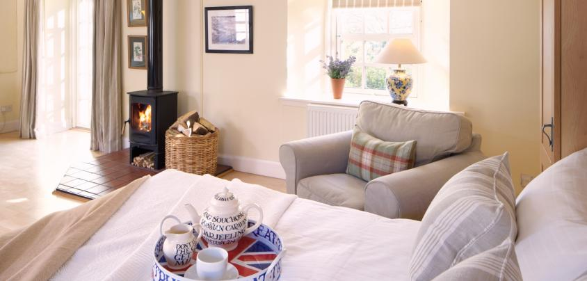 Breakfast in bed with a roaring fire, wood burning stove, folding wall bed, country cottage, Pentland hills, near Edinburgh, Scotland, cottage for couples