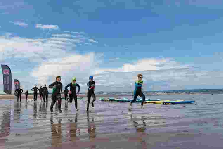 Kids surf lessons near Edinburgh, kids on the beach Scotland, sunny beach, Dunbar, kids activities