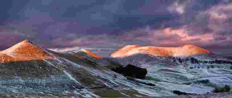 Sunset catching the tops of the Pentlands in winter, pink hills, Kips, Black Hill, Scald Law, Eastside glen, snow covered peaks, Scotland, near Edinburgh