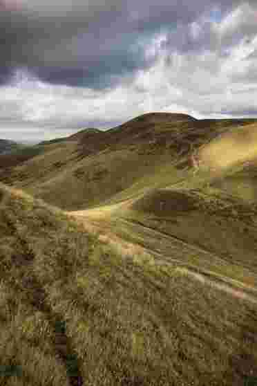 Walking in the spectacular scenery of the Pentland Hills Regional Park near Edinburgh