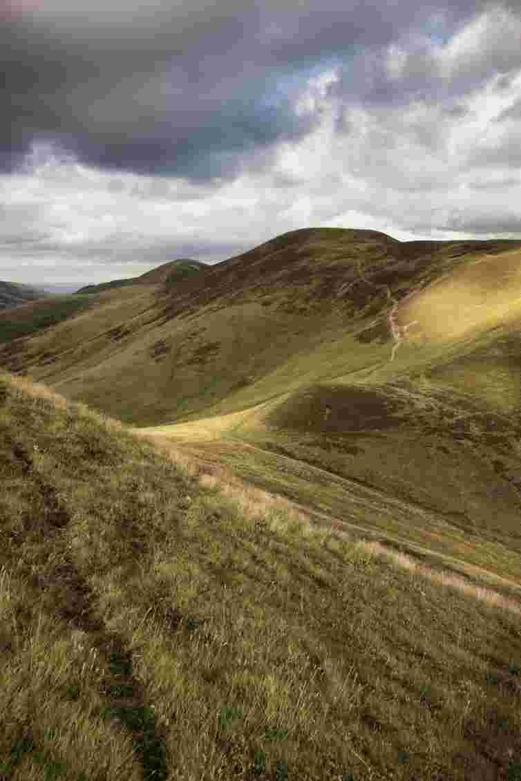 Walking in the spectacular scenery of the Pentland Hills Regional Park near Edinburgh